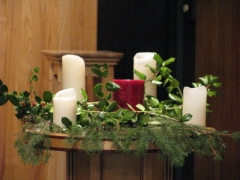 Candles and holly decorating the pulpit area