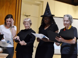 Singers in witch costumes